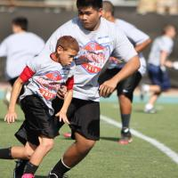 NFL and CFL represent at Michael Bennett youth footbal clinic (1/19/2013)