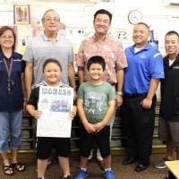 Momilani Elementary third graders receive free dictionaries  from Pearlridge Rot