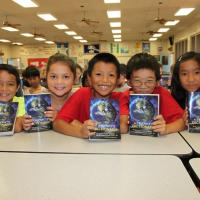 Pearl Ridge Elementary third graders happy to receive free dictionaries from Rot