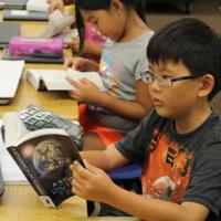 Momilani Elementary third graders receive donated dictionaries from the Rotary C