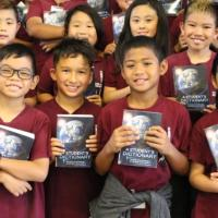 Pearlridge Rotarians deliver free dictionaries to Pearl City third graders (9/6/