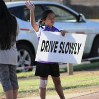Seventh CTAP Signwaving event slows traffic on Kaahele St.