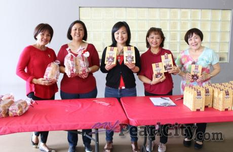 Santa's helpers deliver Punaluu Sweetbread and Mac Cookies to Pearl City Shoppin