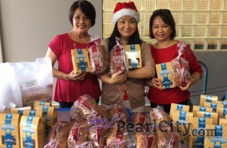 Christmas goodies delivered to Pearl City Shopping Center merchants on Thursday
