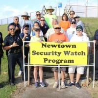 Newtown Neighborhood Security Watch Community Traffic Awareness Program holds si